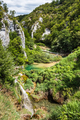 Cascades Waterfalls with turquoise water between the rocks in the woods. Plitvice, National Park, Croatia