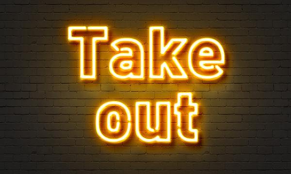 Takeout neon sign on brick wall background.