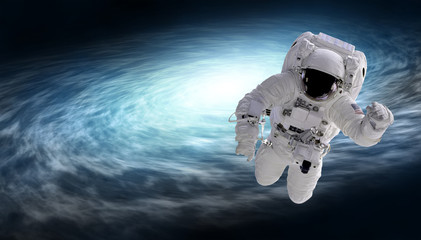 cosmonaut and spiral galaxy, elements of this image furnished by NASA