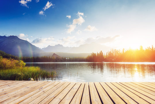 The sunrise over a lake in the park High Tatras.