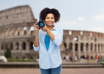 happy afro american woman with digital camera