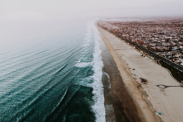 beach town and crashing wave