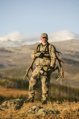 Big Game Hunter With Western Elk Rack On Back
