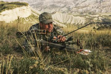 Elk Bowhunter Belly Crawling