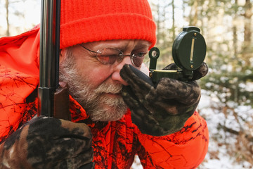Big Game Hunter Using Compass in winter