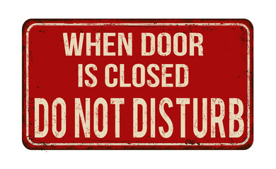 When door is closed do not disturb vintage rusty metal sign