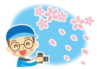 桜吹雪を撮る写真少年