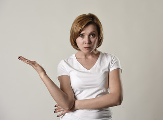 young attractive and moody woman posing alone angry and upset in bad mood and rage face