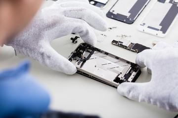 Technician Repairing Mobile Phone