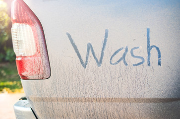Written text Wash on dirty car