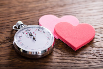 Speed Dating Concept. Hearts And A Stop Watch