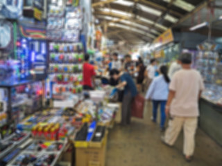 Blur background People shopping at Klong Thom Market place popular on Bangkok, Thailand