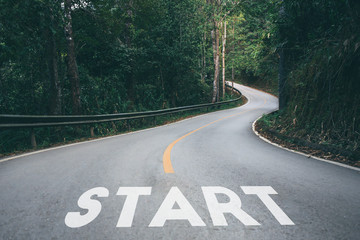 Obraz Startup to success business printed on road leading towards future concept. - fototapety do salonu
