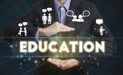 Businessman hand chooses Education wording on interface screen. internet technology knowledge concept.