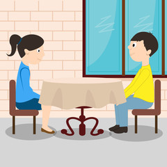 Young romantic couple sitting at the table