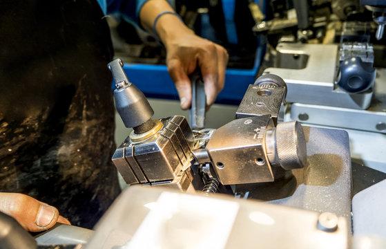 Craftsman sharpener locksmith working