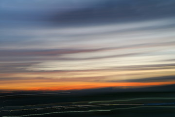 motion blurred line sky in sunset abstract nature blur background.