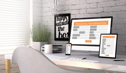Devices with a personal information form on the screen on a workplace mockup