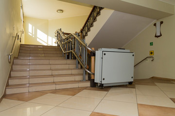 Stair lift for the disabled. Stairs of public building.