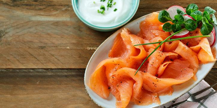 Fresh slices of healthy smoked salmon or lok