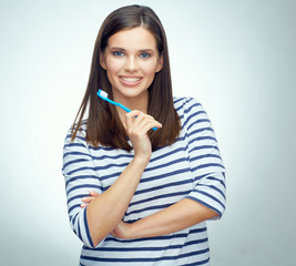 Young woman with brace brushing teeth.