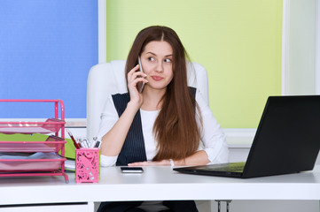 employee in the office is constantly a lot of talking on the phone.