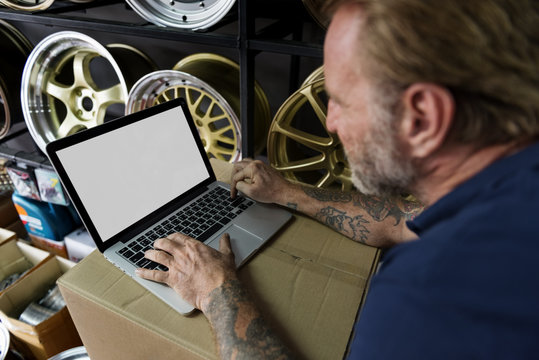Car Parts Shop Owner Warehouse Checking Laptop Concept