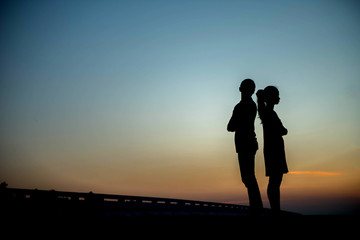 Silhouette couples in love the sky.