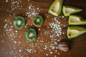 Fresh kiwi, avocado on the desk. Healthy eating.