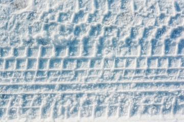 Car trails in fresh snow