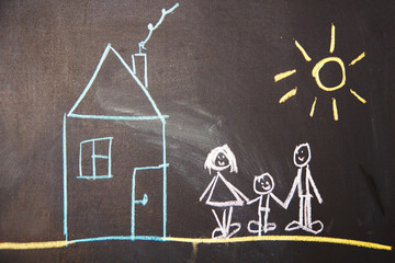 happy family drawn on a chalkboard