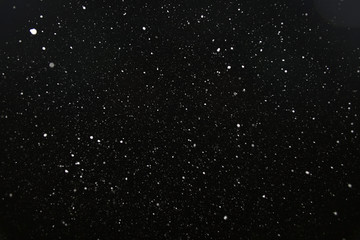 snow on a black background texture overlay bokeh highlights