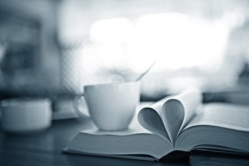 heart from pages of the book concept love tea coffee