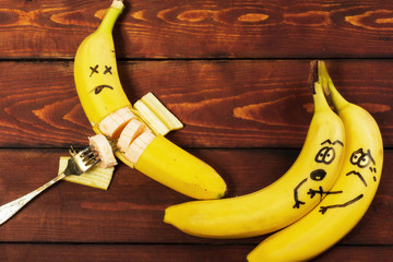 Corpse friend scare a couple of bananas. Fruits are experiencing fear.