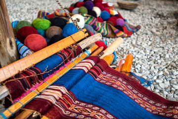 Traditional Quechuan alpaca weaving tools and balls of alpaca yarn