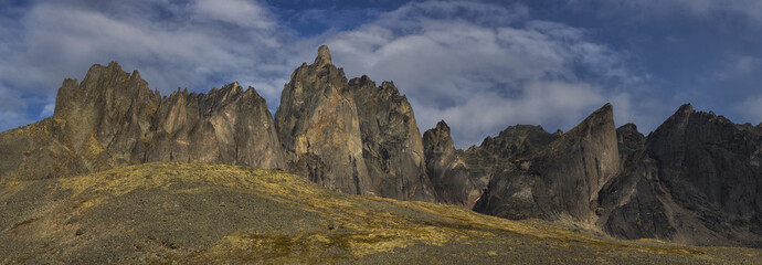 Panoramic image of the tall granite peaks and ridge in Tombstone Territorial Park; Yukon, Canada