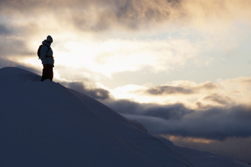 Snowboarder silhouetted on a mountain, St. Moritz, Switzerland