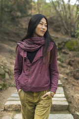 Portrait of female model walking on a mountain trail; Xiamen, China