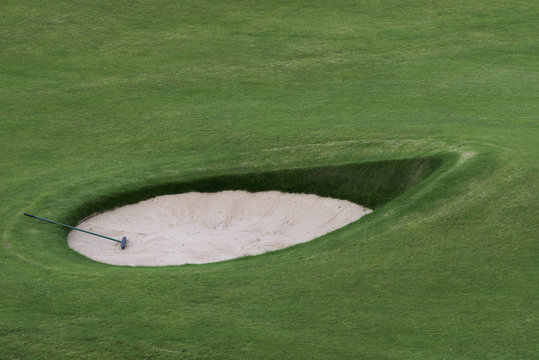 Golf club in a sand trap on a golf course; Maidens, Ayrshire, Scotland