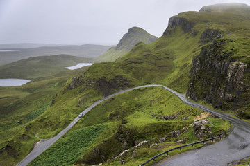A road winding through the mountains, Highlands; Staffin, Scotland