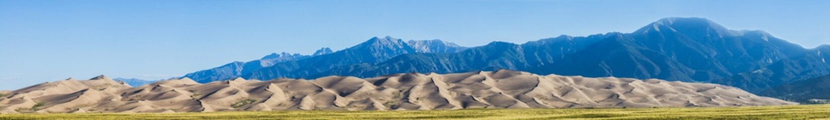 Panoramic view of the sand dunes and Sangre de Cristo Mountains in Great Sand Dunes National Park and Preserve; Colorado, United States of America