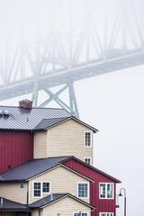 The Astoria-Megler Bridge disappears into the fog; Astoria, Oregon, United States of America