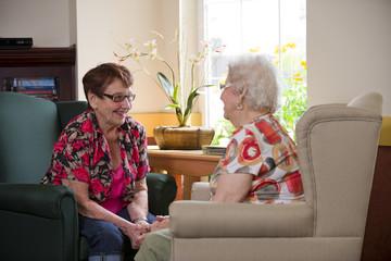 Senior citizens enjoying life in their shared residence; Devon, Alberta, Canada