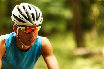 Portrait of mountain biker with helmet and sunglasses.