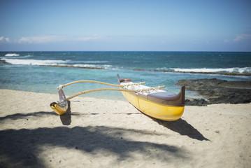 Outrigger canoe on the beach; Island of Hawaii, Hawaii, United States of America