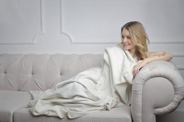 Lying under a warm blanket