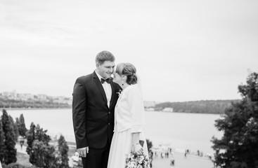 Wedding couple background city landscape panorama with lake. Black and white photo.
