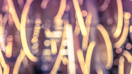 Blurred lights electric bulbs bokeh picture in vintage style.
