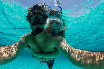 Couple snorkeling underwater
