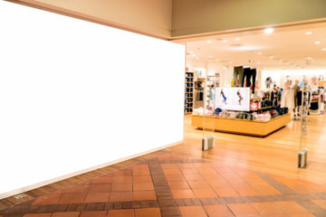Blank poster in front of store,Blank decoration backdrop for advertising store information.Selective focus on white billboard.